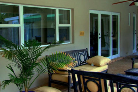 house patio with hurricane impact resistant windows and french doors